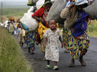 Congolese flee the eastern town of Sake, just west of Goma, on Friday. Fighting between rebel and government forces in the east of the Democratic Republic of Congo has displaced at least 100,000 people.