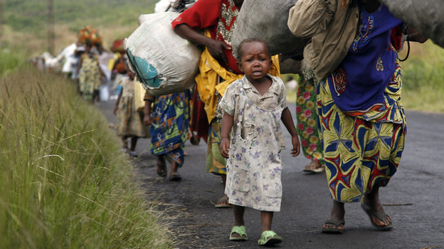 Congolese flee the eastern town of Sake, just west of Goma, on Friday. Fighting between rebel and government forces in the east of the Democratic Republic of Congo has displaced at least 100,000 people. (AP)