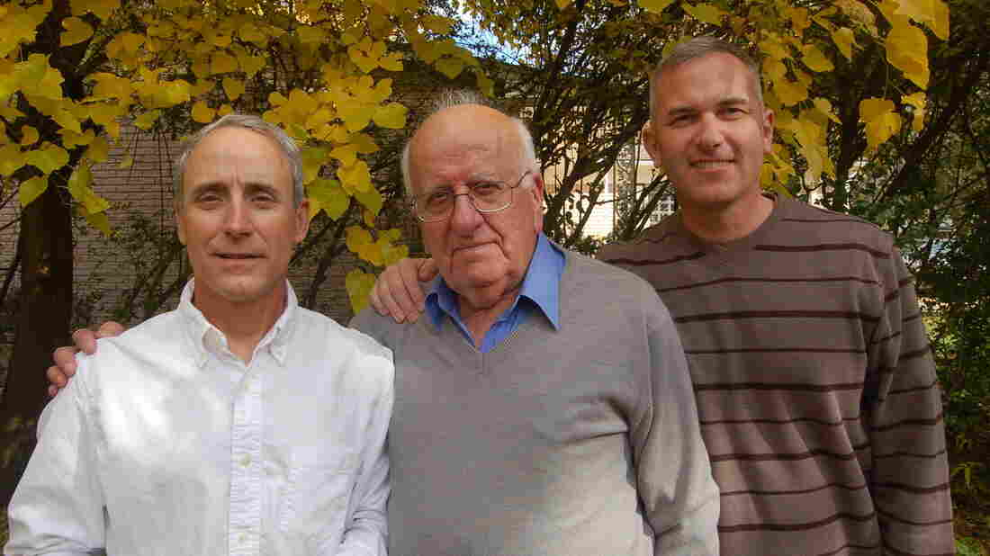 Col. Eric Schwartz (left), Dr. Najeeb Hanoudi (center) and Maj. Ron Cooper outside Hanoudi's home in Southfield, Mich.