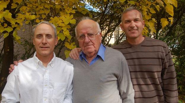 Col. Eric Schwartz (left), Dr. Najeeb Hanoudi (center) and Maj. Ron Cooper outside Hanoudi's home in Southfield, Mich. (Emily Fox)