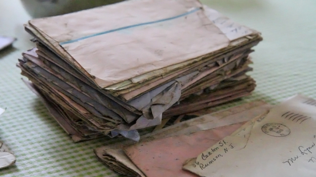 Kathleen Chaney and her son Patrick found the storm-soaked stack of letters as they were walking along the New Jersey shore. (Newsworks.org)