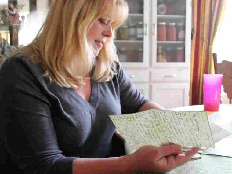 Katheleen Chaney reads one of the love letters she found on the beach near her home in New Jersey after Superstorm Sandy.