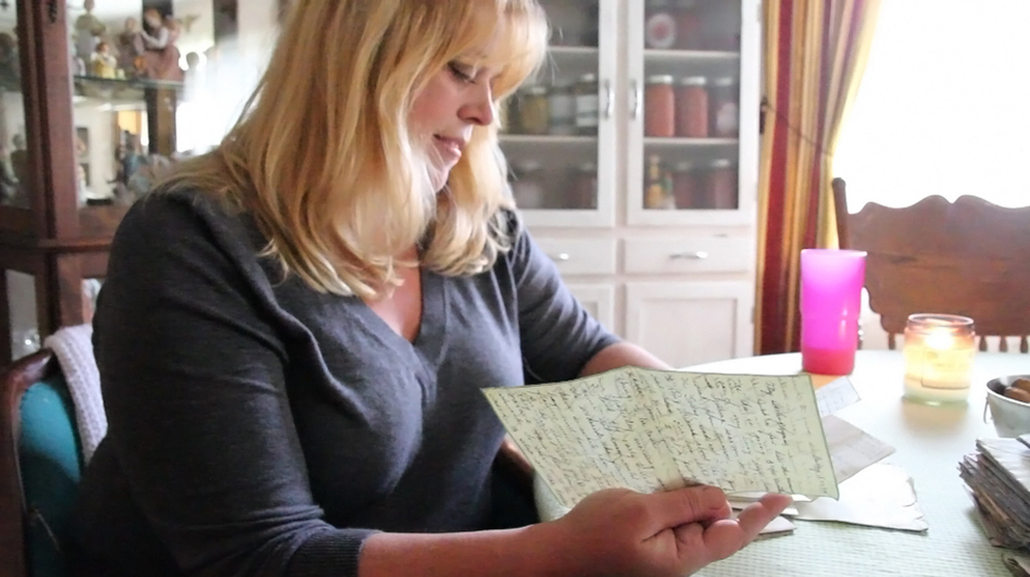 Katheleen Chaney reads one of the love letters she found on the beach near her home in New Jersey after Superstorm Sandy. (Lindsay Lazarski for NPR)