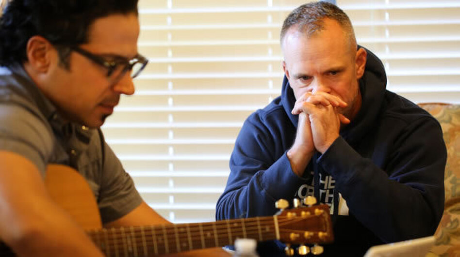 Songwriter Jay Clementi works on a song with Sgt. 1st Class Scott McRae at the weekend retreat near Fort Hood in Central Texas. (Jorge Sanhueza-Lyon for NPR)