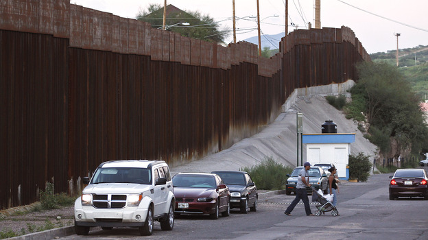 Pedestrians cross the street in Nogales, Mexico, near the border with Arizona. A U.S. Border Patrol agent shot and killed a 16-year-old boy who was throwing rocks near the border fence last month. (AP)