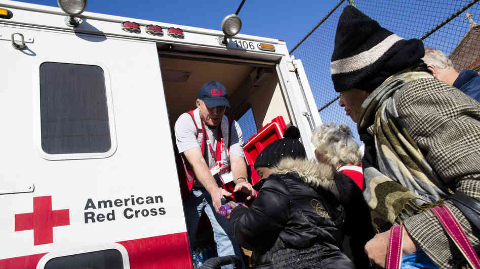 A member of the Red Cross distributes food to residents of Coney Island affected by Superstorm Sandy in the Brooklyn, N.Y., on Nov. 9.
