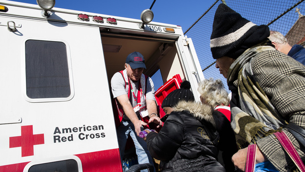 A member of the Red Cross distributes food to residents of Coney Island affected by Superstorm Sandy in the Brooklyn, N.Y., on Nov. 9. (AP)