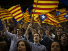 Supporters of center-right Catalan Nationalist Coalition leader Artur Mas wave pro-independence flags during the last day of campaigning in Barcelona, Spain, on Friday.