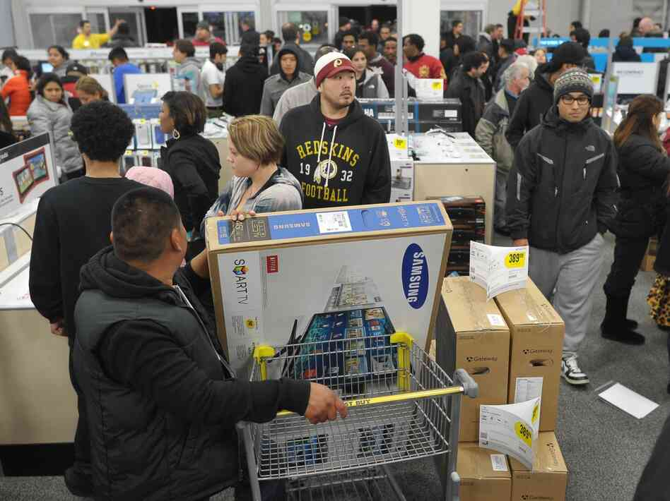 Shoppers line up in a Best Buy store in Rockville, Md., during a Black Friday sale. Thanksgiving weekend sales jumped nearly 13 percent from last year, the National Retail Federation says.