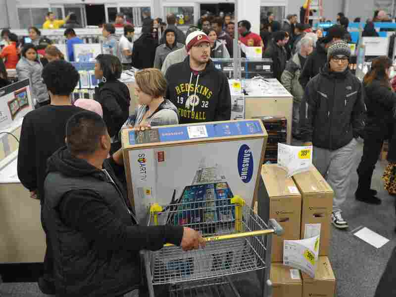 Shoppers line up in a Best Buy store in Rockville, Md., during a Black Frid