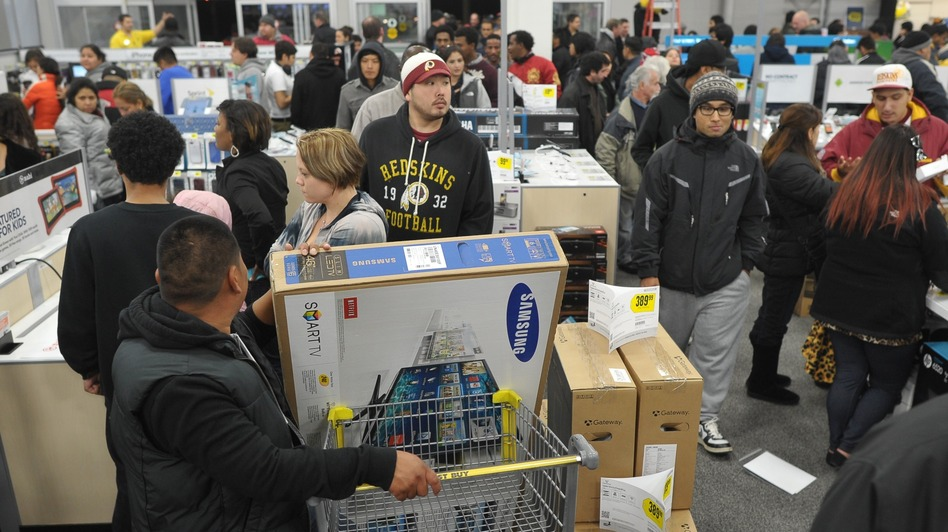 Shoppers line up in a Best Buy store in Rockville, Md., during a Black Friday sale. Thanksgiving weekend sales jumped nearly 13 percent from last year, the National Retail Federation says. (AFP/Getty Images)
