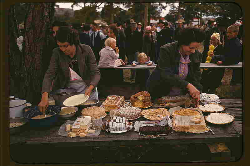 Cutting pies and cakes at a barbecue dinner, 1940