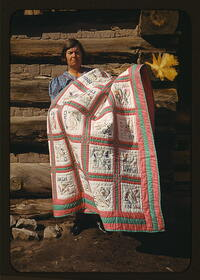 Mrs. Bill Stagg with state quilt, 1940