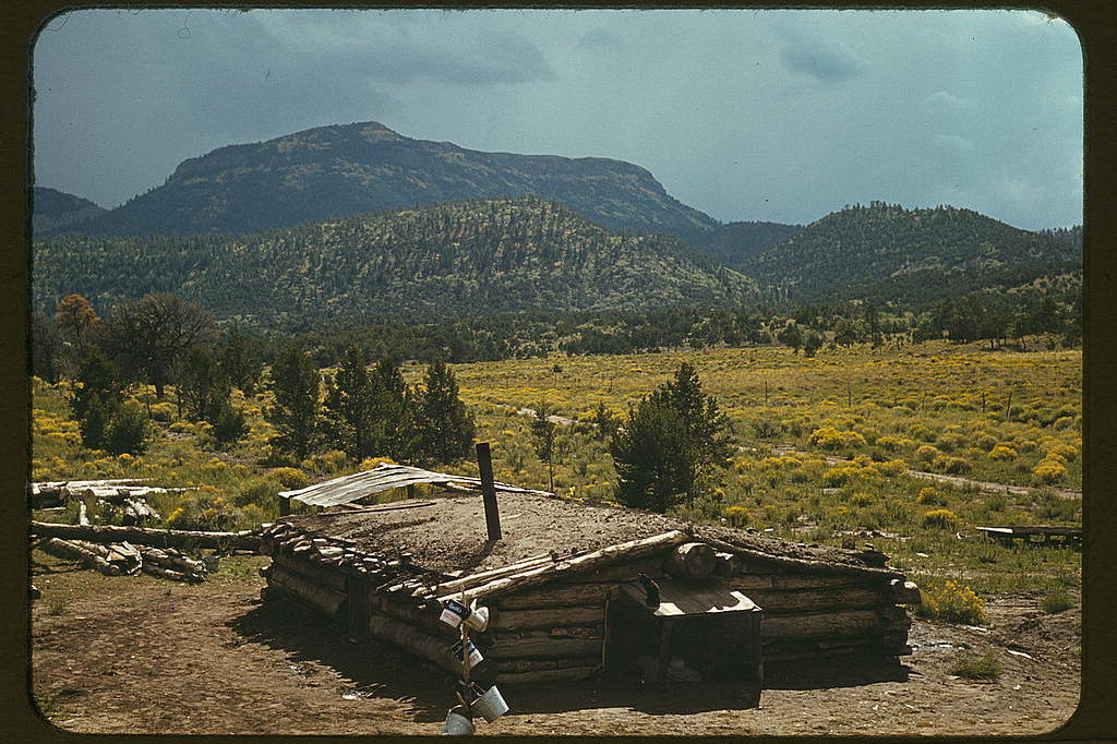 Dugout house of Faro Caudill, homesteader, with Mount Allegro in the background, 1940