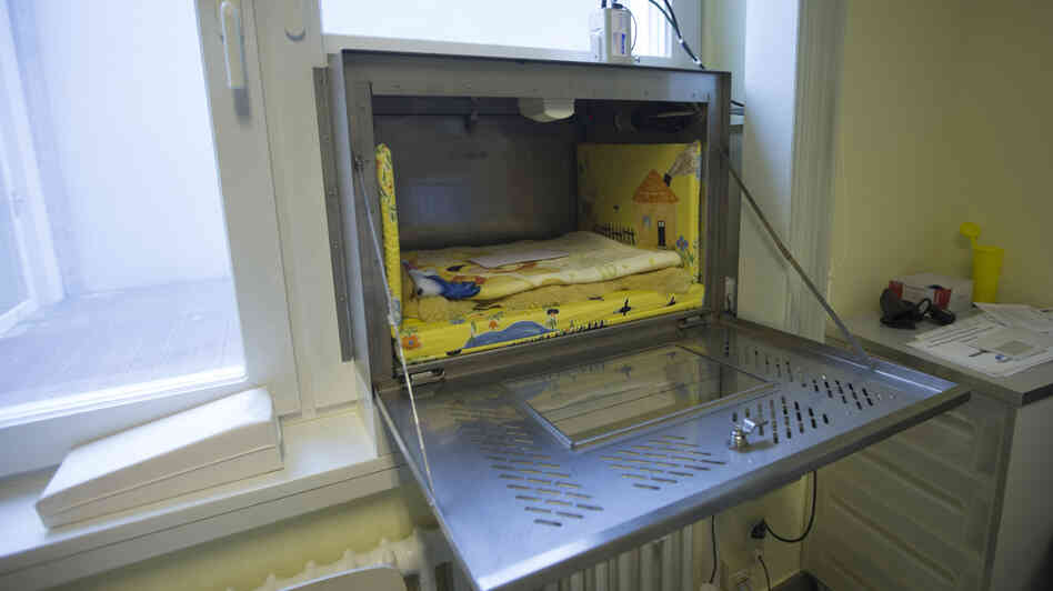 "A baby hatch that is fixed in a window at Waldfriede Hospital in Berlin. Mothers can bring  unwanted babies and leave them anonymously. Baby boxes are a revival of the medieval ""foundling wheels,"" where unwanted infants were left in revolving church doors."