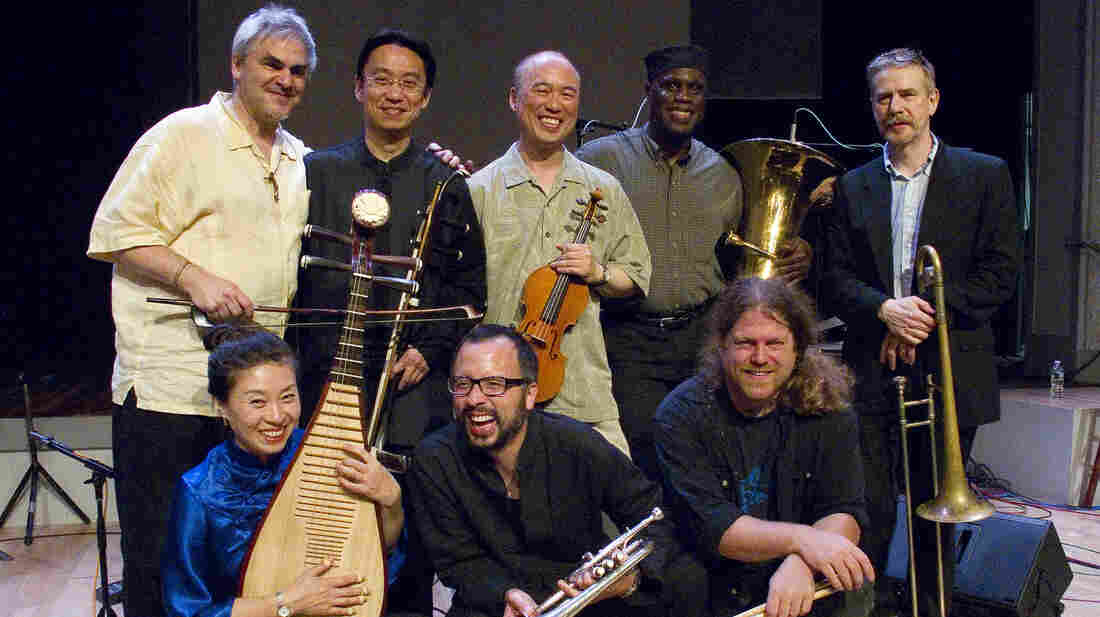 Burning Bridge personnel, left to right: Jason Kao Hwang (violin), Wang Guowei (erhu), Sun Li (pipa), Ken Filiano (string bass), Andrew Drury (drum set), Joseph Daley (tuba), Steve Swell (trombone), Taylor Ho Bynum (cornet/flugelhorn).