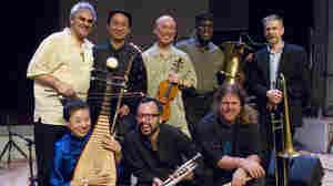 Burning Bridge personnel, left to right: Jason Kao Hwang (violin), Wang Guowei (erhu), Sun Li (pipa), Ken Filiano (string bass), Andrew Drury (drum set), Joseph Daley (tuba), Steve Swell (trombone), Taylor Ho Bynum (cornet/flugelhorn).
