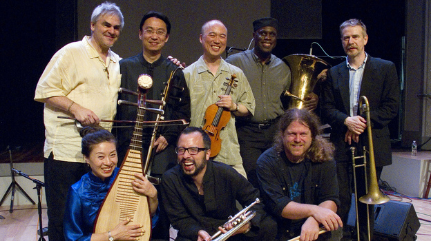 Burning Bridge personnel, left to right: Jason Kao Hwang (violin), Wang Guowei (erhu), Sun Li (pipa), Ken Filiano (string bass), Andrew Drury (drum set), Joseph Daley (tuba), Steve Swell (trombone), Taylor Ho Bynum (cornet/flugelhorn). (Courtesy of the artist)