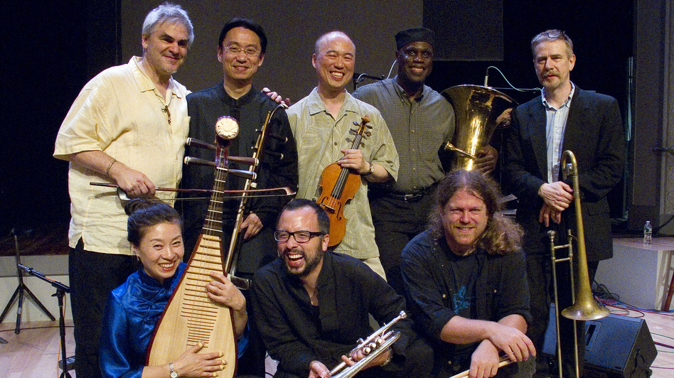 Burning Bridge personnel, left to right: Jason Kao Hwang (violin), Wang Guowei (erhu), Sun Li (pipa), Ken Filiano (string bass), Andrew Drury (drum set), Joseph Daley (tuba), Steve Swell (trombone), Taylor Ho Bynum (cornet/flugelhorn). (Courtesy of the artist)