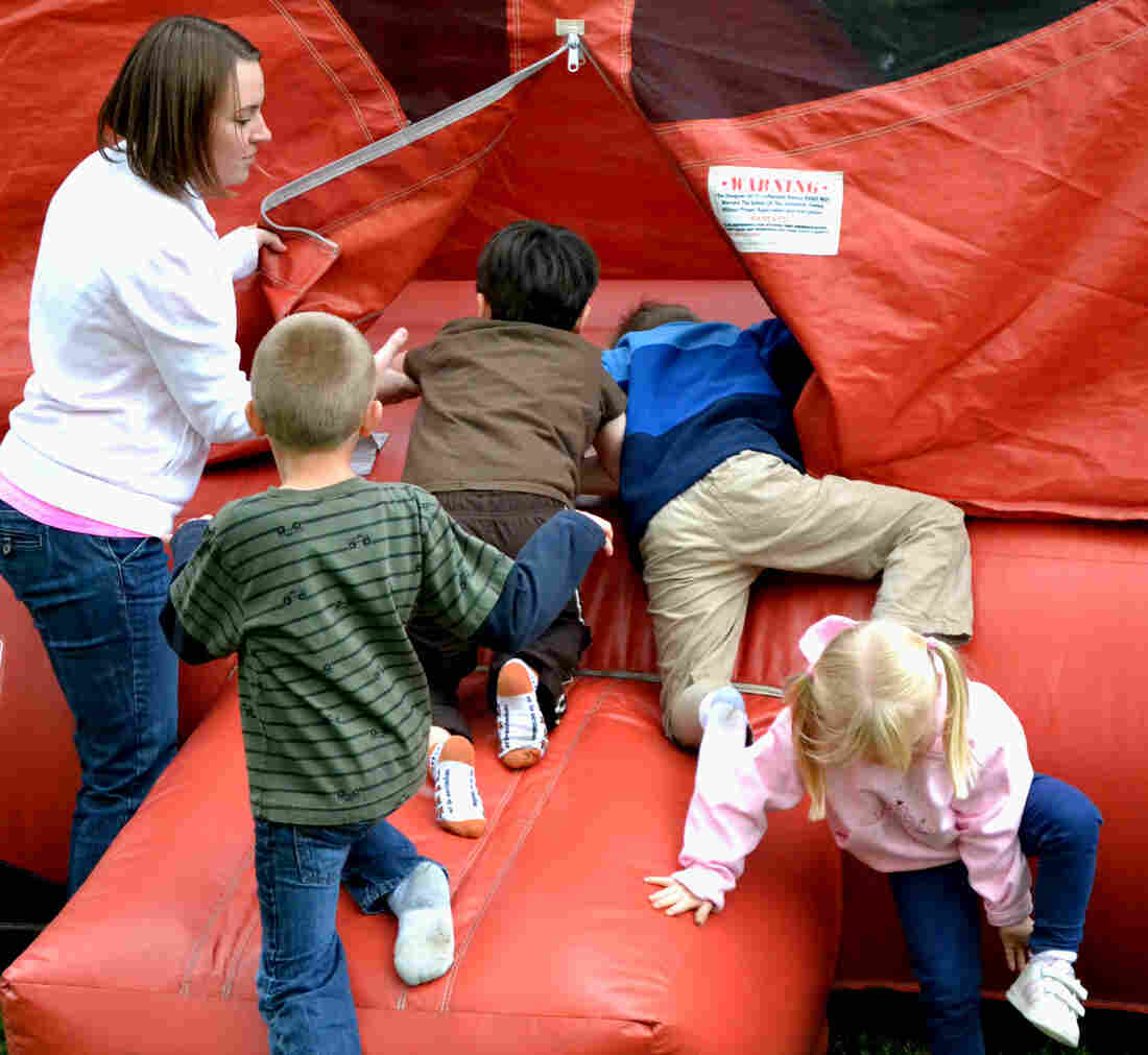 First the kids pile in, then the bouncing begins.