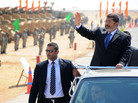 Egyptian President Mohammed Morsi waves at soldiers at a military base in Ismailia, Egypt, in October. Morsi's recent decrees have angered judges who are planning to strike.