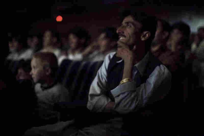 The audience at Pamir Cinema in Kabul watches a Pakistani film.