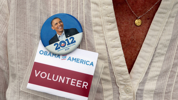 A campaign volunteer wears a button as President Obama speaks at a campaign event in Maumee, Ohio. Now that the election is over, the Obama team is trying to keep supporters engaged in the president's second term.