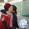 Former U.S. Olympian Lorrie Fair hugs Zahra Mahmoudi, the captain of the Afghan women's soccer team.