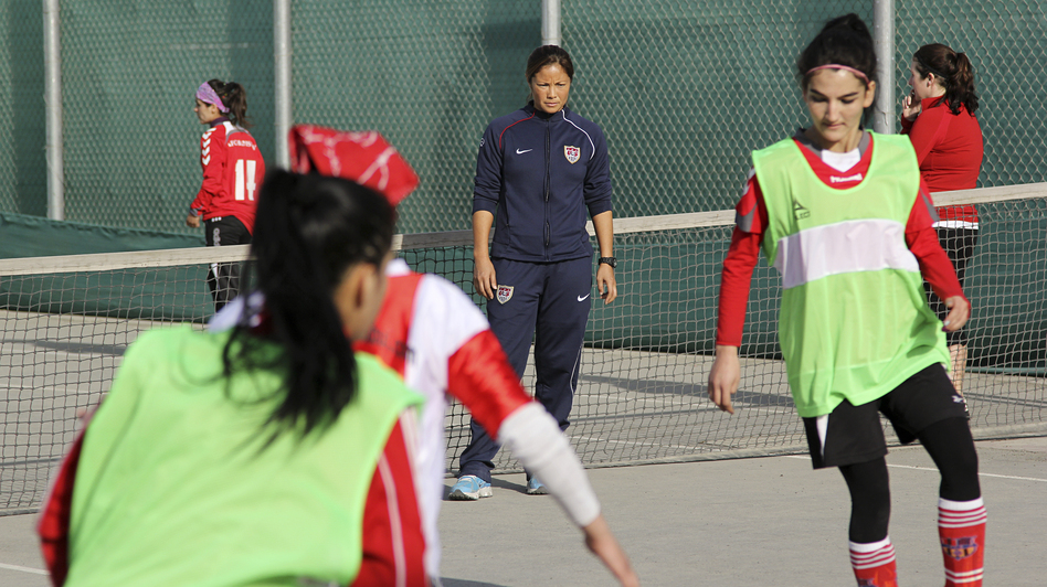 Former U.S. Olympic soccer player Lorrie Fair (in blue sweats) holds a recent clinic for the Afghan women's soccer team at the U.S. Embassy in Kabul. (NPR)