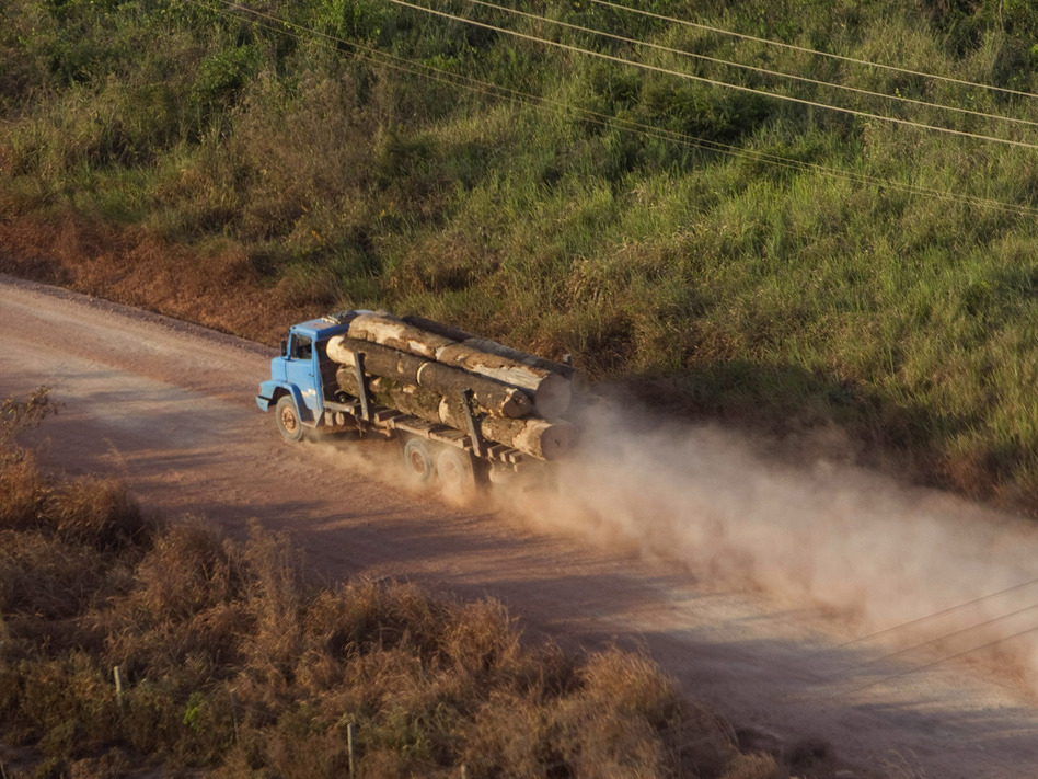 "A truck carrying hardwood timber drives along a rural road leading to Paragominas, Brazil, on Sept. 23, 2011. The city has become a pioneering ""Green City,"" a model of sustainability with a new economic approach that has seen illegal deforestation virtually halted."