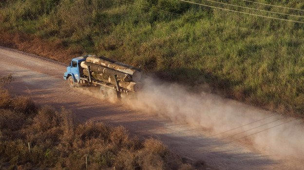 "A truck carrying hardwood timber drives along a rural road leading to Paragominas, Brazil, on Sept. 23, 2011. The city has become a pioneering ""Green City,"" a model of sustainability with a new economic approach that has seen illegal deforestation virtually halted. (AP)"