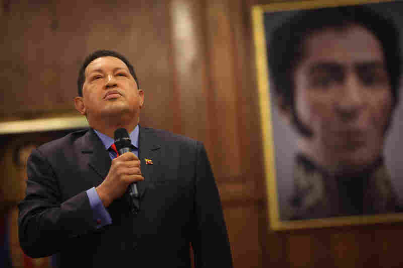 Standing next to a portrait of independence hero Simon Bolivar, Venezuelan President Hugo Chavez speaks during a press conference at Miraflores Palace in the capital, Caracas, in October 2012.