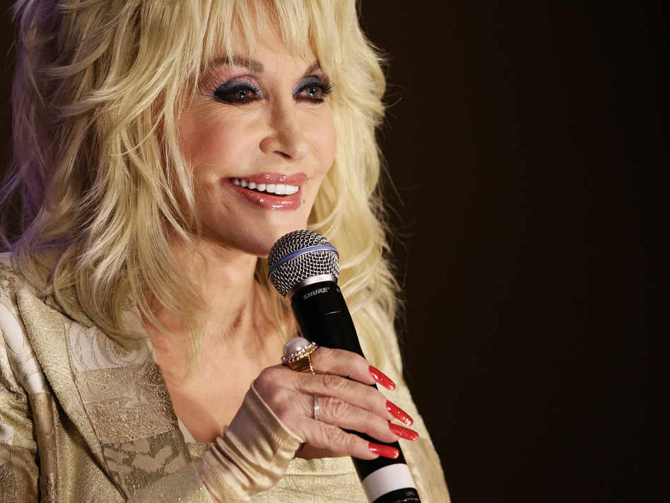 "Dolly Parton, known as ""The Queen of Country Music,"" has won eight Grammys and sold more than 100 million records. (Brendon Thorne/Getty Images)"