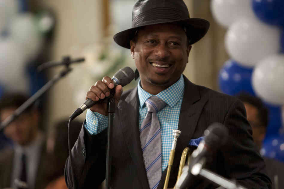 Kermit Ruffins (playing himself) performs at a Bar Mitzvah.