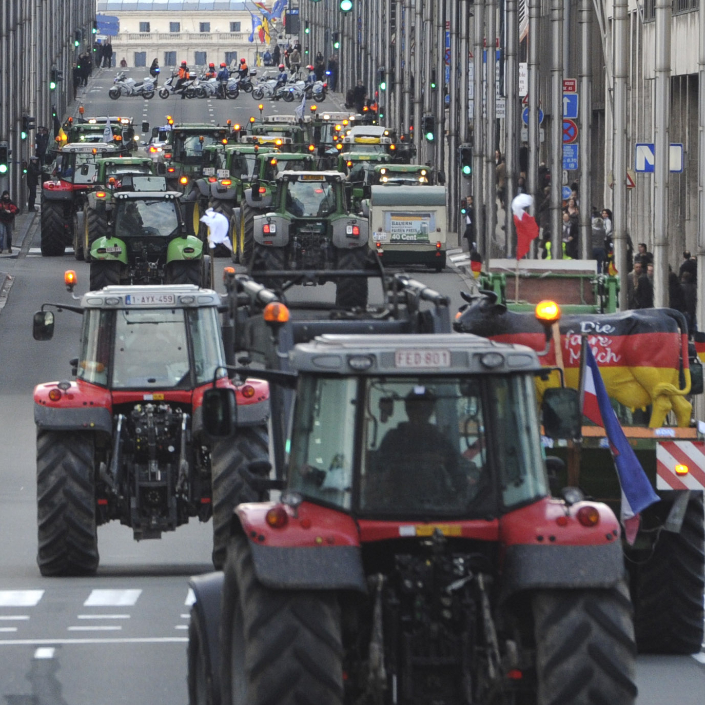 European milk farmers drive their tractors down a main thoroughfare in the European Quarter of Brussels on Monday.