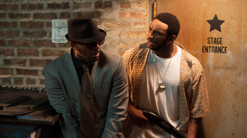 R. Kelly (left) as Sylvester, and Eric Lane as Twan, in Trapped in the Closet, which relaunched with new chapters last week on IFC. (IFC)