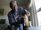 Keith Gresham, 65, lines up four medications he takes at his home in Detroit in 2011. The self-employed painter was without health insurance for about a decade and was happy to finally turn 65 last year so he could qualify for Medicare.