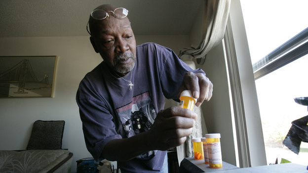 Keith Gresham, 65, lines up four medications he takes at his home in Detroit in 2011. The self-employed painter was without health insurance for about a decade and was happy to finally turn 65 last year so he could qualify for Medicare. (MCT/Landov)