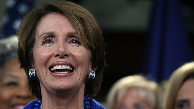 House Minority Leader Rep. Nancy Pelosi smiles while speaking to the media. (Getty Images)