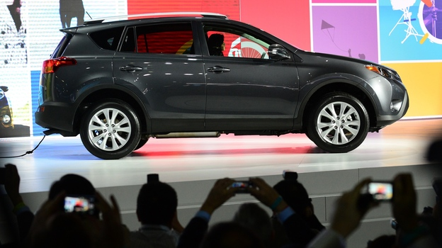 Toyota unveils its new RAV4 crossover SUV to the media Wednesday before the L.A. Auto Show opens to the public. (AFP/Getty Images)