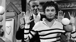 In 1955's Daddy Long Legs, Leslie Caron plays a French orphan who goes to college thanks to help from an anonymous, American benefactor (Fred Astaire).