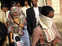 """Shaheen Dhada (left) and Renu Srinivasan leave court in Mumbai on Nov. 19. Dhada was arrested for a Facebook post questioning the shutdown of Mumbai for the funeral of a powerful politician; Srinivasan was arrested for """"liking"""" the post."""