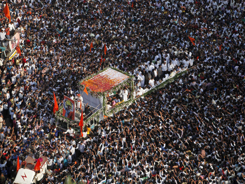 Thousands of mourners gather beside a truck carrying the body of Bal Thackeray, the leader of the Hindu hard-line Shiv Sena party, during his funeral in Mumbai on Nov. 18. (AP)