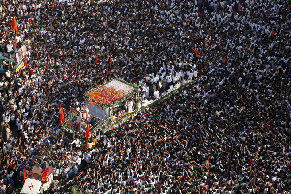 Thousands of mourners gather beside a truck carrying the body of Bal Thackeray, the leader of the Hindu hard-line Shiv Sena party, during his funeral in Mumbai on Nov. 18.