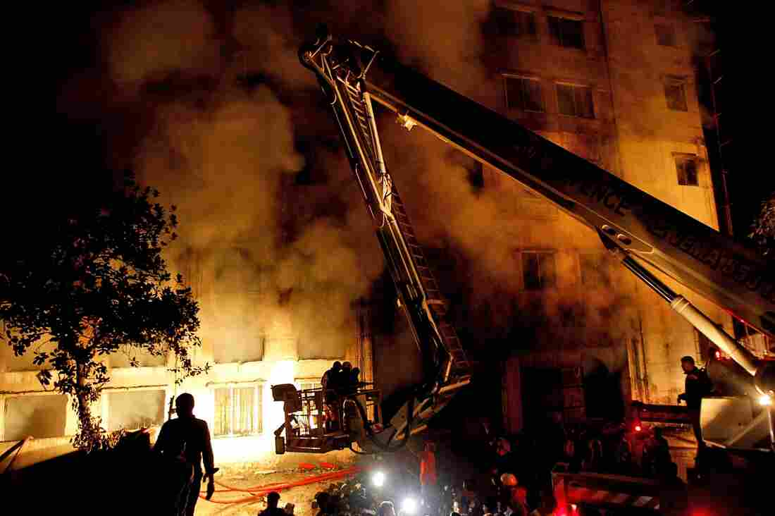 Firefighters attack a factory fire near Dhaka, Bangladesh on Saturday, Nov. 24. More than 100 people were killed in the blaze.
