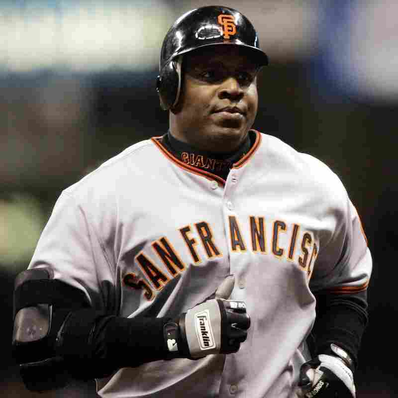 Barry Bonds rounding the bases after hitting his 734t