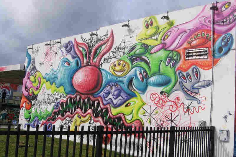 Los Angeles artist Kenny Scharf's cartoonlike mural greets visitors to Wynnwood Walls.