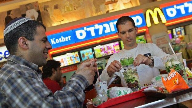 Israelis eat at a kosher McDonald's restaurant in Tel Aviv. (Getty Images)
