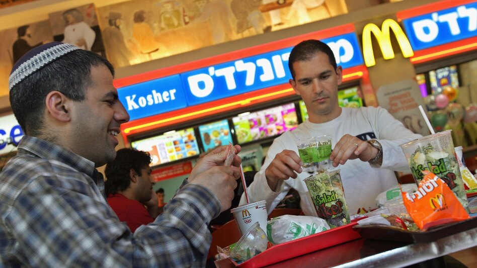 Israelis eat at a kosher McDonald's restaurant in Tel Aviv. (Getty Images)