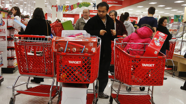 Shoppers at a Target store in Westbury, N.Y., last week. Consumer spending drives the economy. And the holiday shopping season is crucial for retailers. (Reuters /Landov)